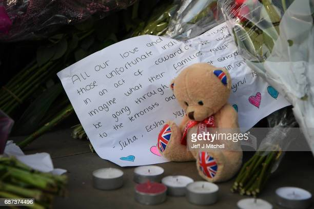 A tribute is laid at a candlelit vigil to honour the victims of Monday evening's terror attack at Albert Square on May 23 2017 in Manchester England...