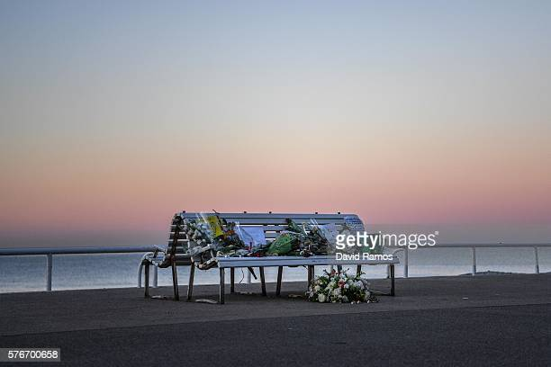 A tribute is laid on a bench near where a person was killed on the Promenade des Anglais on July 17 2016 in Nice France Six people believed to be...