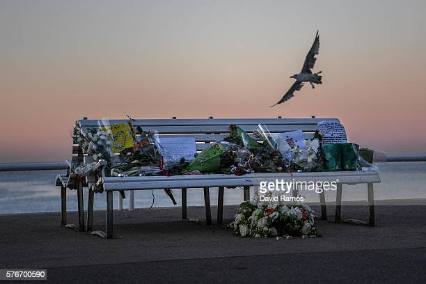 A tribute is laid on a bench where a person was killed on the Promenade des Anglais on July 17 2016 in Nice France Six people believed to be linked...