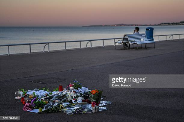A tribute is laid on the ground where a person was killed on the Promenade des Anglais on July 17 2016 in Nice France Six people believed to be...