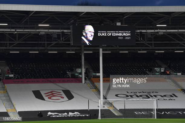 Tribute to Britain's Prince Philip, Duke of Edinburgh is featured on a billboard ahead of the English Premier League football match between Fulham...