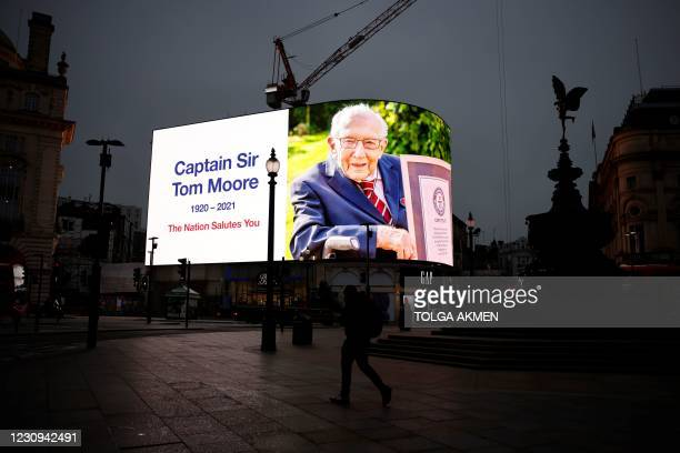 Tribute to Captain Tom Moore is shown on digital advertising boards in Piccadilly Circus in central London on February 3, 2021. - Captain Tom Moore,...
