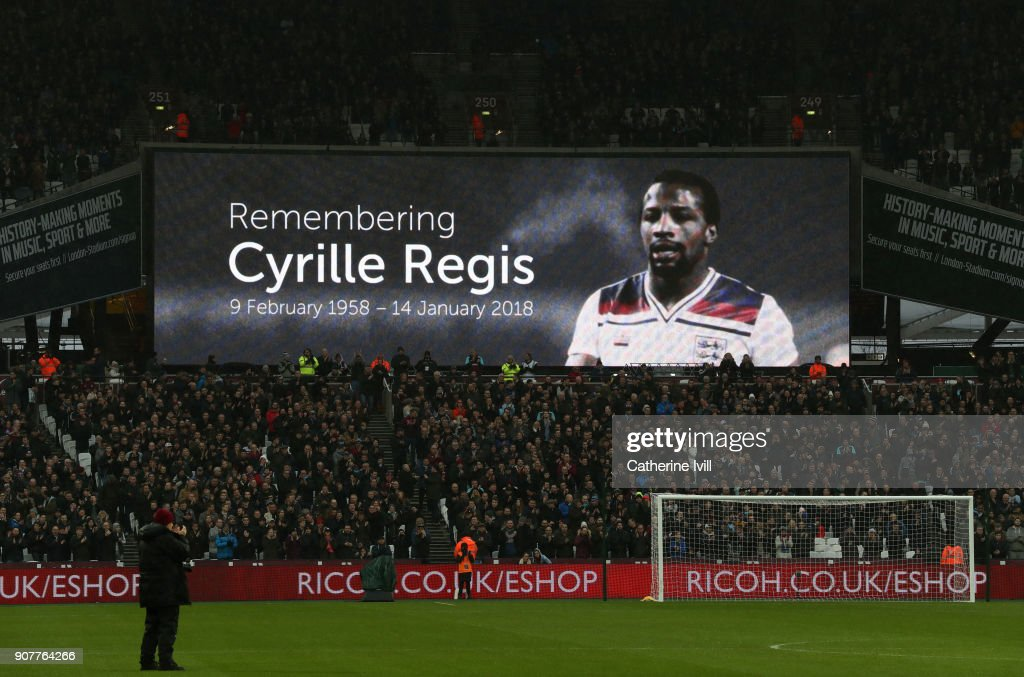A tribute to Cyrille Regis is displayed on the screen during the Premier League match between West Ham United and AFC Bournemouth at London Stadium on January 20, 2018 in London, England.