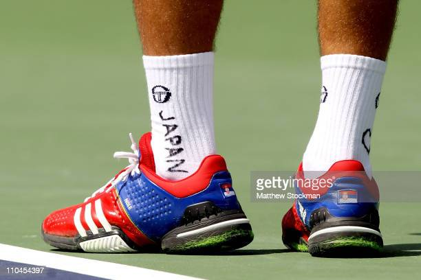 Tribute to Japan writen on the socks of Novak Djokovic of Serbia worn during his match against Richard Gasquet of France during the BNP Paribas Open...