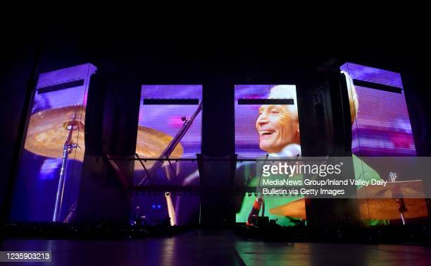 Tribute to late Rolling Stones drummer Charlie Watts is shown across the stage prior to the band taking the stage during the first of two shows at...
