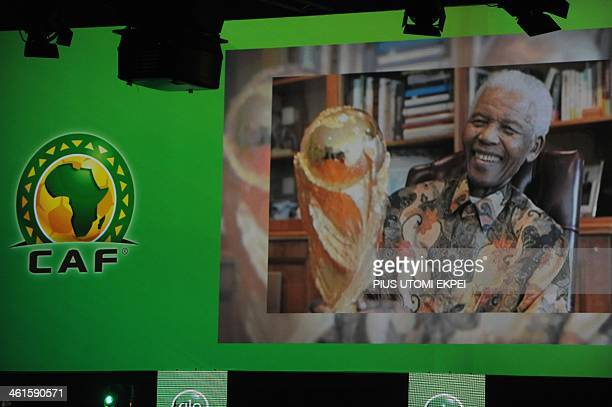 A tribute to late South African leader Nelson Mandela is shown on the screen during the CAF African Footballer of the Year Award in Lagos on January...