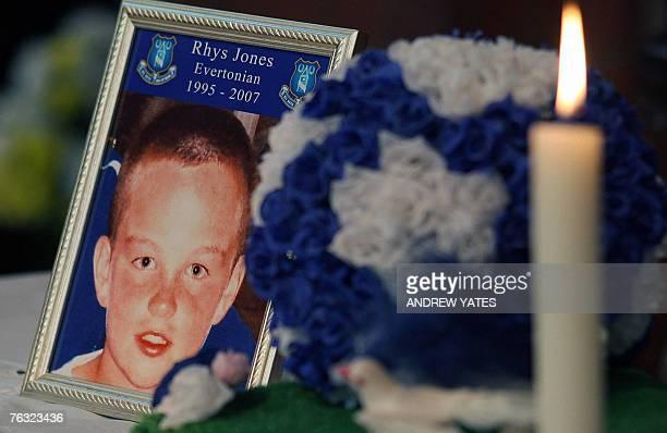A tribute to murdered 11 yearold Rhys Jones is displayed inside Saint Luke the Evangelist church in Liverpool northwest England 25 August 2007 Jones...