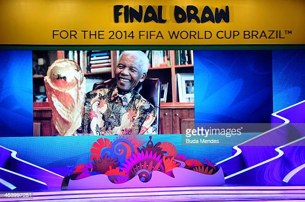 A tribute to Nelson Mandela is displayed on a screen on stage before the Final Draw for the 2014 FIFA World Cup Brazil at Costa do Sauipe Resort on...