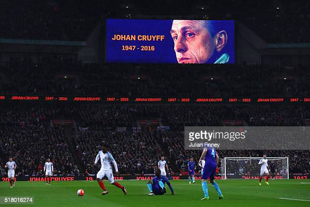 Tribute to remember Johan Cruyff of Netherlands on the big screen as match action continues during the International Friendly match between England...