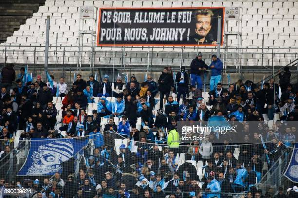 Tribute to singer Johnny Halliday during the Ligue 1 match between Olympique Marseille and AS SaintEtienne at Stade Velodrome on December 10 2017 in...