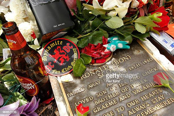 Tributes adorn the memorial of Bon Scott on the 30th anniversary of AC/DC's former frontman's death at Fremantle cemetery on February 19 2010 in...
