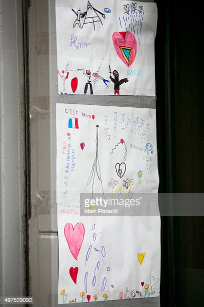 Tributes and flowers are left near the 'La Belle Equipe' restaurant on November 17 2015 in Paris France Paris remains under heightened security...