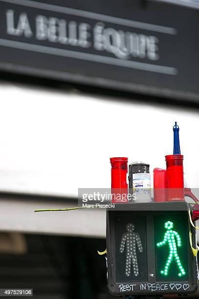 Tributes and flowers are left near the 'La Belle Equipe' restaurant on November 17, 2015 in Paris, France. Paris remains under heightened security...