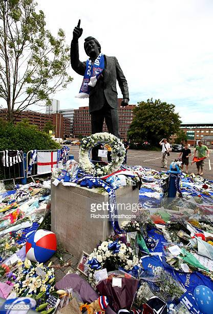 Tributes and memories laid by fans are seen at the feet of the Sir Bobby Robson statue outside Portman Road the stadium of Ipswich Town FC on August...