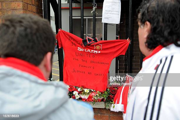 Tributes are laid out at the Eternal Flame memorial and fans pay respect to the victims of the Hillsborough tragedy before the Barclays Premier...