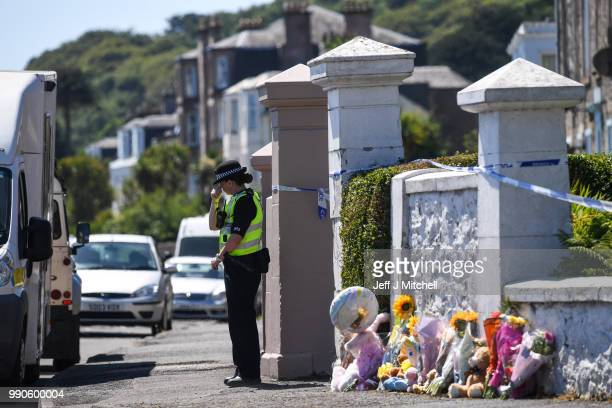 Tributes are left for six year old Alesha MacPhail at a house on Ardbeg Road on July 3 2018 on the Isle of Bute Scotland Police investigations are...