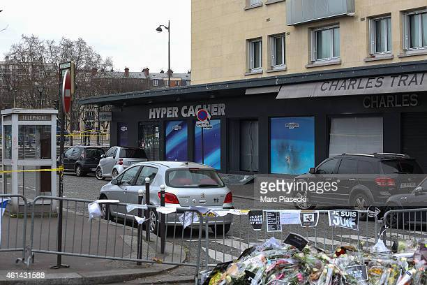 Tributes are left in the area while Benjamin Netanyahu Prime Minister of Israel pays his respects at the Hyper Cacher following the recent terrorist...