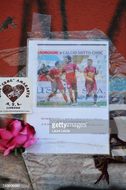 Tributes are left outside Armando Picchi Stadium, where the coffin of footballer Piermario Morosini was displayed for fans and supporters to pay...