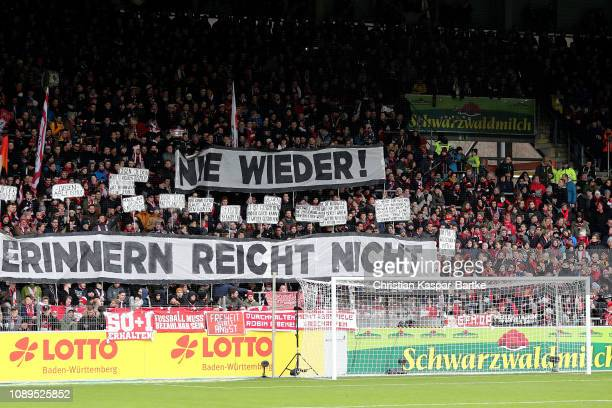 Tributes are made to victims of the Holocaust prior to the Bundesliga match between SportClub Freiburg and TSG 1899 Hoffenheim at SchwarzwaldStadion...