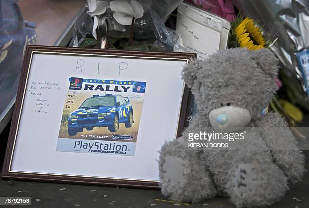 Tributes are placed at the entrance to the home of former world rally champion Colin McRae in Lanark in Scotland 17 September 2007 McRae and his...