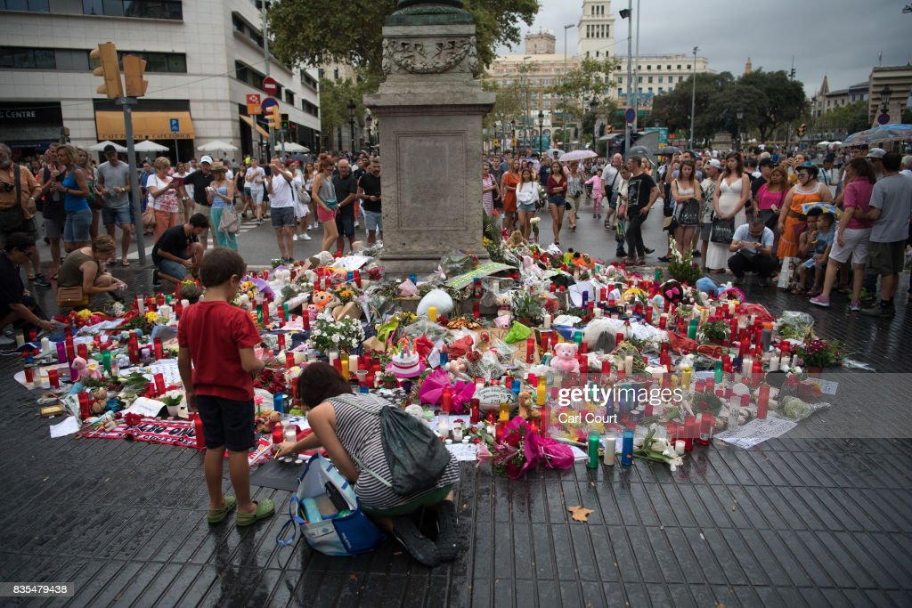 Tributes are placed on Las Ramblas near the scene of Thursday's terrorist attack, on August 19, 2017 in Barcelona, Spain. A nationwide manhunt continues for Younes Abouyaaqoub, now named by Spanish media as the suspected driver in an attack that left thirteen people dead and dozens injured when a van was driven at crowds in the popular Las Ramblas area of Barcelona on Thursday.