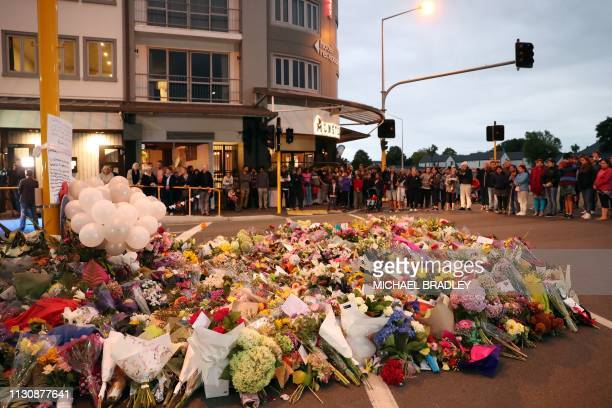 Tributes are seen as mourners pay their respects for victims of the March 15 mosque attacks in Christchurch on March 16 2019 A rightwing extremist...