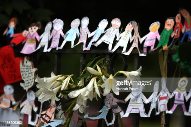 Tributes are seen hanging on the wall of the Botanic Gardens on March 18 2019 in Christchurch New Zealand 50 people are confirmed dead with with 36...