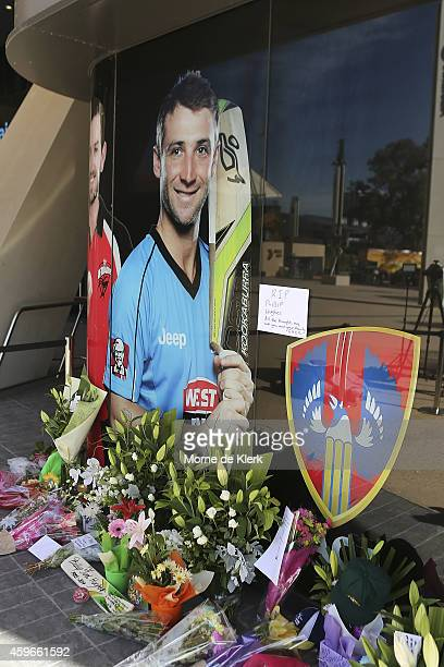 Tributes are seen lying next to a photograph of Phil Hughes outside the Adelaide Oval on November 28 2014 in Adelaide Australia Cricket player Phil...
