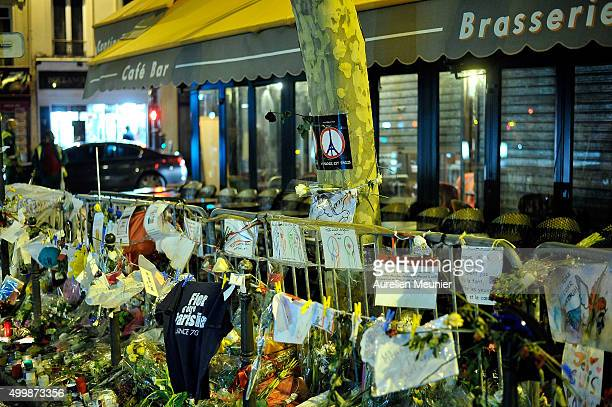 Tributes are seen outside 'La Bonne Biere', which re-opens today after the Paris terrorist attacks, on December 4, 2015 in Paris, France. Five people...