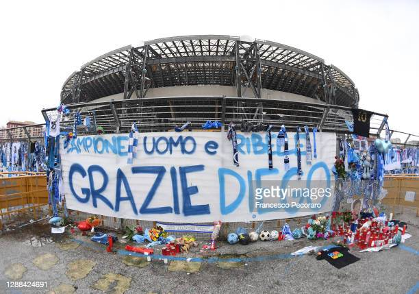 Tributes are seen to the deceased Diego Maradona outside the stadium prior to the Serie A match between SSC Napoli and AS Roma at Stadio San Paolo on...