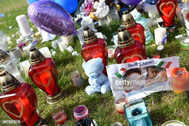TOPSHOT Tributes for terminallyill British toddler Alfie Evans who died on Saturday are left outside the Alder Hey Children's hospital in Liverpool...