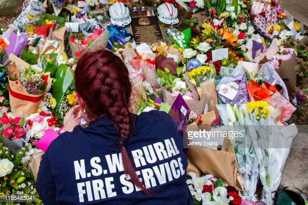 Tributes for volunteers Geoffrey Keaton and Andrew O'Dwyer are seen at Horsley Park Rural Fire Brigade on December 22, 2019 in Sydney, Australia. The...