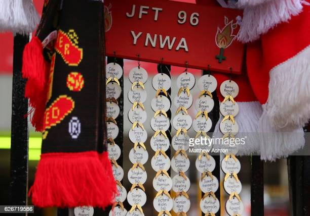 Tributes hang on the Shankly Gates alongside the Hillsborough memorial outside Anfield stadium the home of Liverpool Football Club
