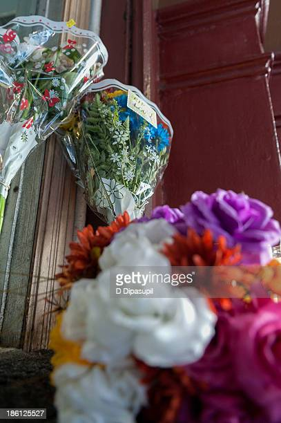 Tributes in memory of rock musician Lou Reed are placed outside the Hotel Chelsea on October 28, 2013 in New York City. Lou Reed, aged 71, died at...