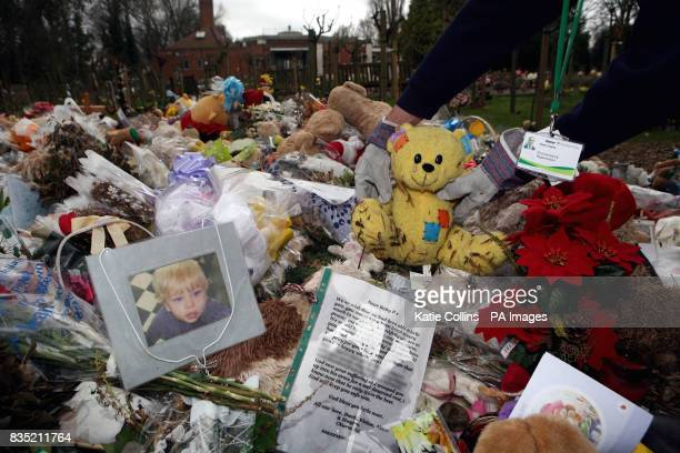 Tributes left in memory of Baby P are carefully placed on a cart to be taken away recorded and stored indoors at Islington and St Pancras Cemetery in...