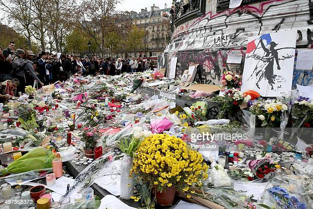 Tributes lie on the Place de La Republique square monument on November 16 2015 in Paris France Countries across Europe will join France currently...