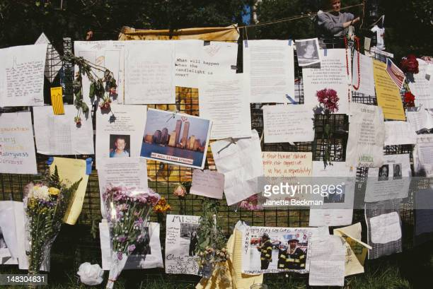 Tributes, messages and appeals for information on missing persons, attached to a fence in New York City after the September 11 attacks, September...