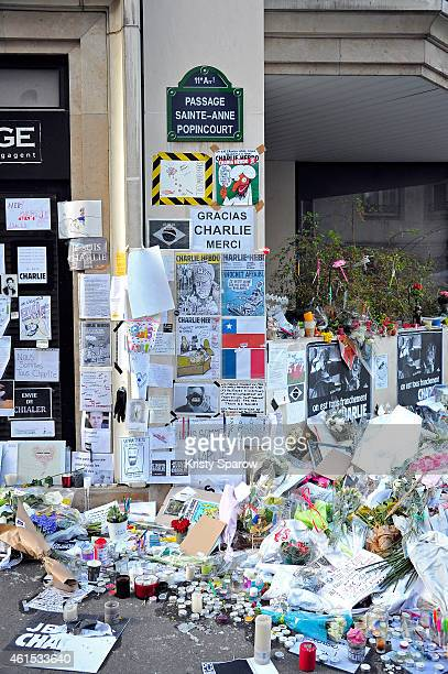 Tributes of drawings flowers pens and candles are left near the Charlie Hebdo offices on January 14 2015 in Paris France Released today an initial...