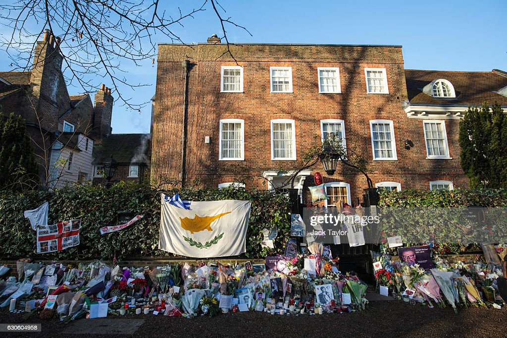 Tributes Of Flowers Photographs And Candles Are Left Outside The Home Pop Music Icon