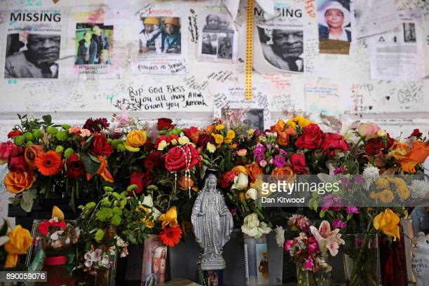 Tributes still stand near Grenfell Tower on December 11 2017 in London England An inquiry into the Grenfell Tower fire was is due to open for two...