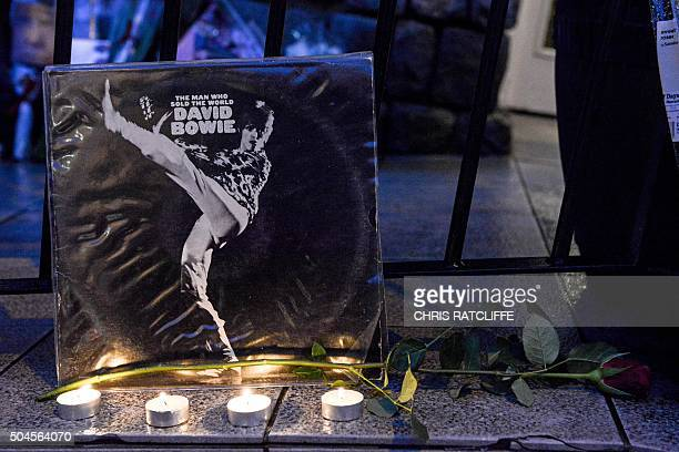 Tributes to British musician David Bowie are seen outside a restaurant in Beckenham, south London, on January 11 following the announcement of...