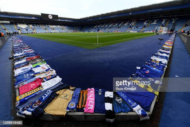 Tributes to Leicester City chairman Vichai Srivaddhanaprabha are seen around the edge of the pitch prior to the Premier League match between...
