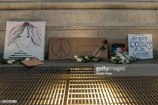 Tributes to the Paris attack victims sit next to the Washington Square Arch after the mass vigil held their memory Around New York City residents and...
