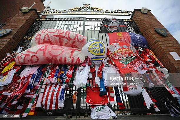 Tributes to the victims of the Hillsborough Disaster adorn the Hillsborough memorial and the Bill Shankly gates at Anfield stadium on September 17...
