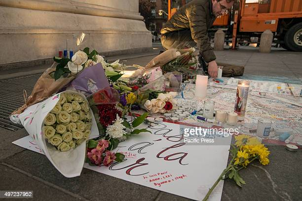 Tributes to the victims of the Paris terrorist attacks lie under the Washington Square Arch after the vigil held in their memory Around New York City...