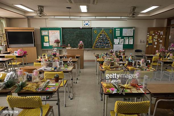 Tributes to victims of the Sewol ferry disaster are displayed in their classroom at Danwon high school in Ansan south of Seoul on April 11 2015 South...