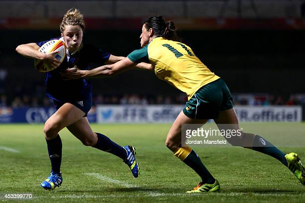 Tricia Brown of France is tackled by Camille Grassineau of Australia during the IRB Women's Rugby World Cup Pool C match between Australia and France...