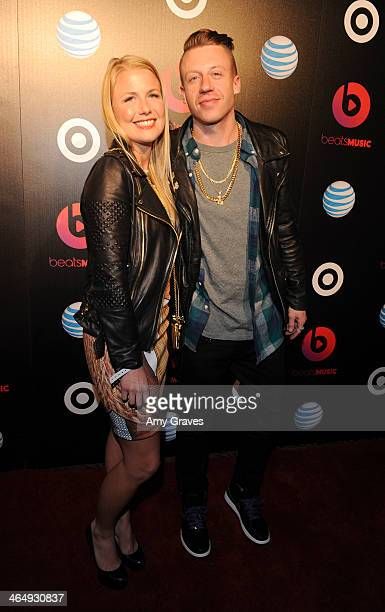 Tricia Davis and recording artist Macklemore attend Beats Music Launch Party At Belasco Theatre at Belasco Theatre on January 24 2014 in Los Angeles...