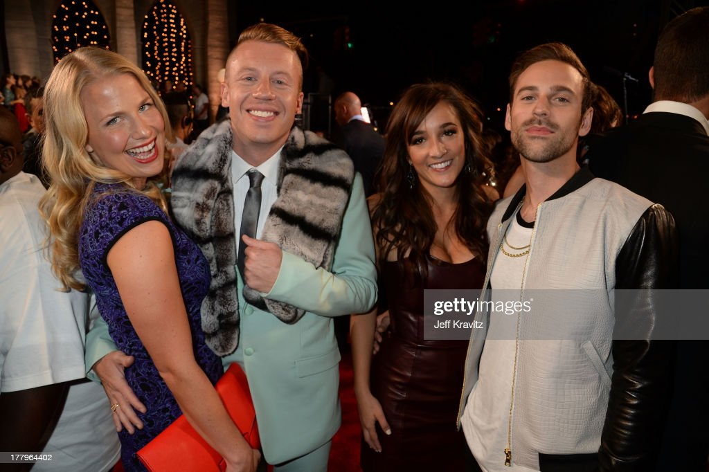 Tricia Davis, Macklemore, guest, Ryan Lewis attend the 2013 MTV Video Music Awards at the Barclays Center on August 25, 2013 in the Brooklyn borough of New York City.