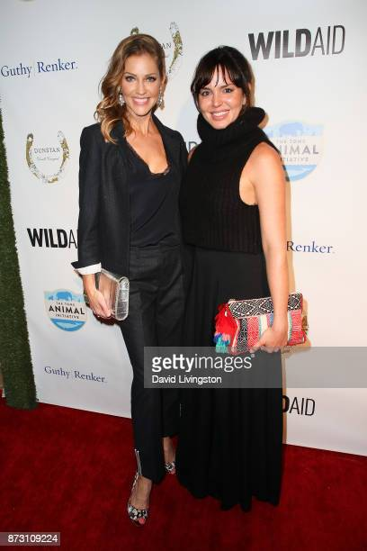 Tricia Helfer and Marta Milans arrive at the Evening with WildAid at the Beverly Wilshire Four Seasons Hotel on November 11 2017 in Beverly Hills...
